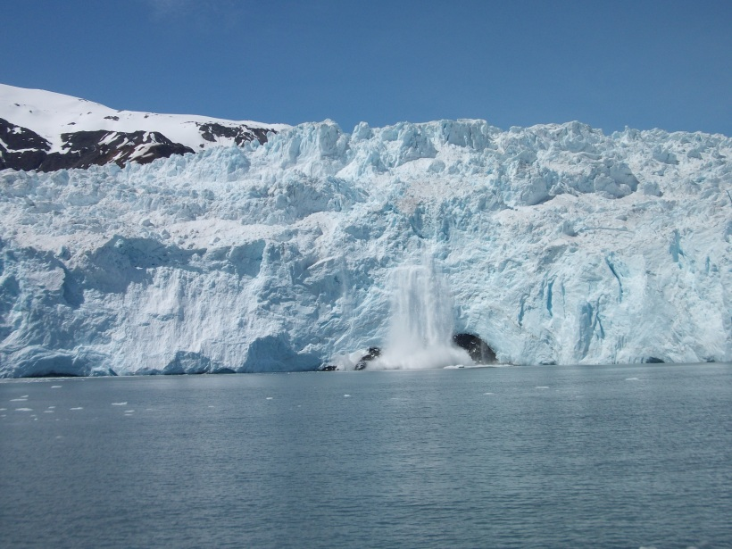 Ice breaking off Aialik Glacier.