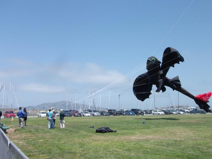 Guys flying a huge kite.